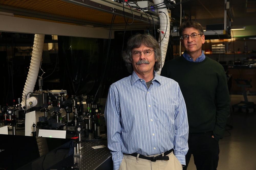 Michael Raymer (left) and Andy Marcus in their lab.